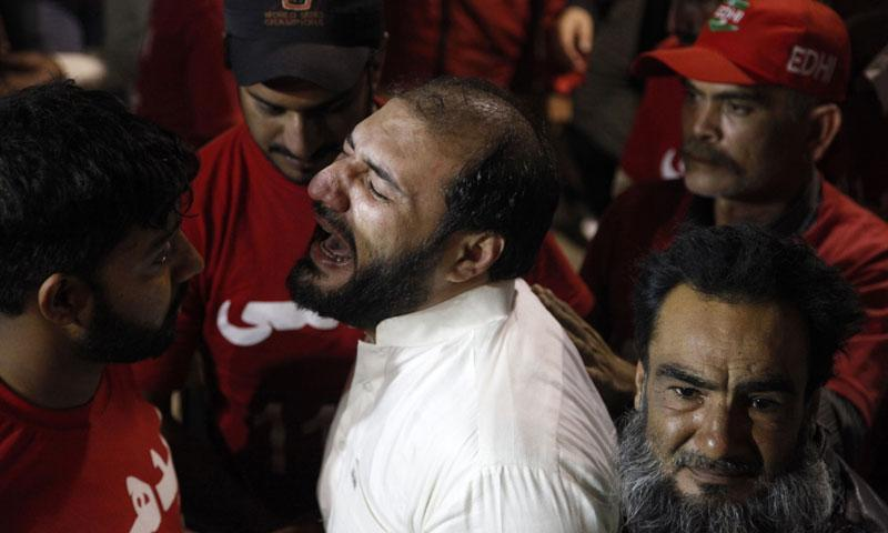 A brother of a slain religious cleric cries at a local hospital in Karachi, Pakistan, Friday, Jan. 17, 2014. — Photo by AP