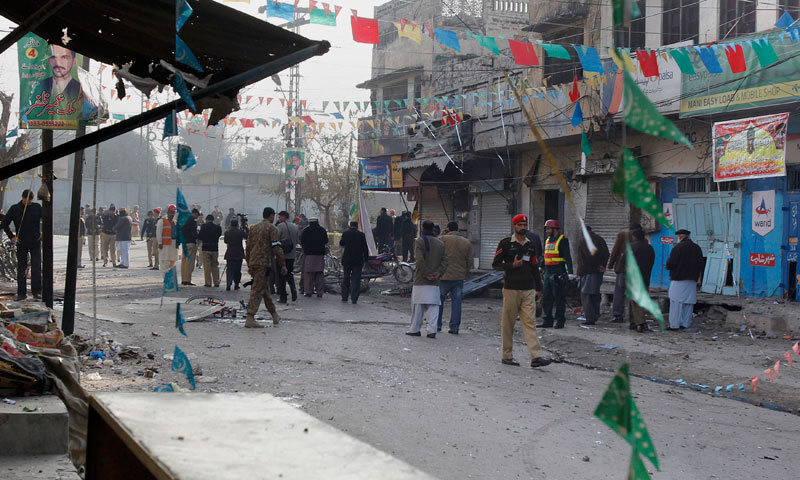 Security officials examine the site of a suicide bombing in Rawalpindi, Pakistan, Monday, Jan. 20, 2014. — Photo by AP