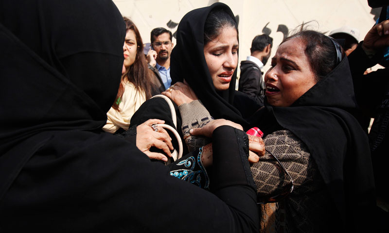 Relatives of a female polio vaccination worker, who was killed by unidentified gunmen, mourn outside a morgue in the Jinnah Post Graduate Medical Center in Karachi Jan 21, 2014. — Photo by Reuters
