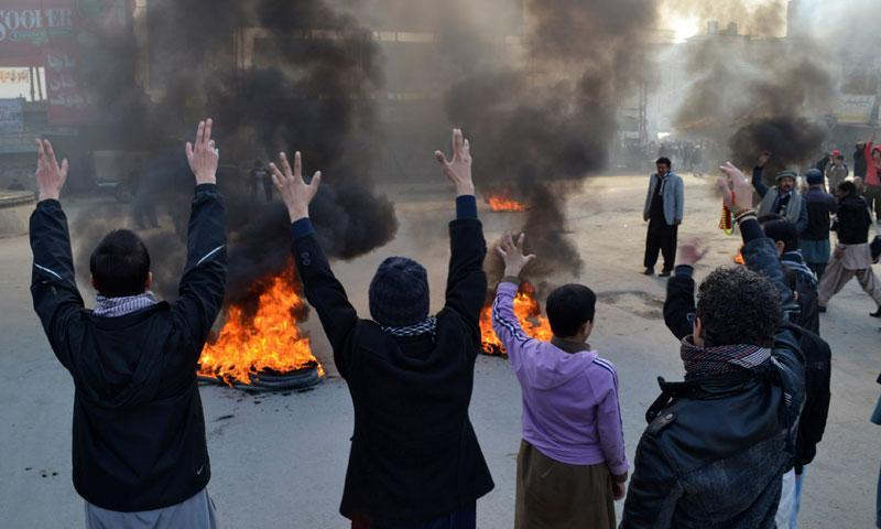 Protestors chant slogans and burn tires, during a protest in Quetta, Wednesday, Jan. 22, 2014.—AP Photo