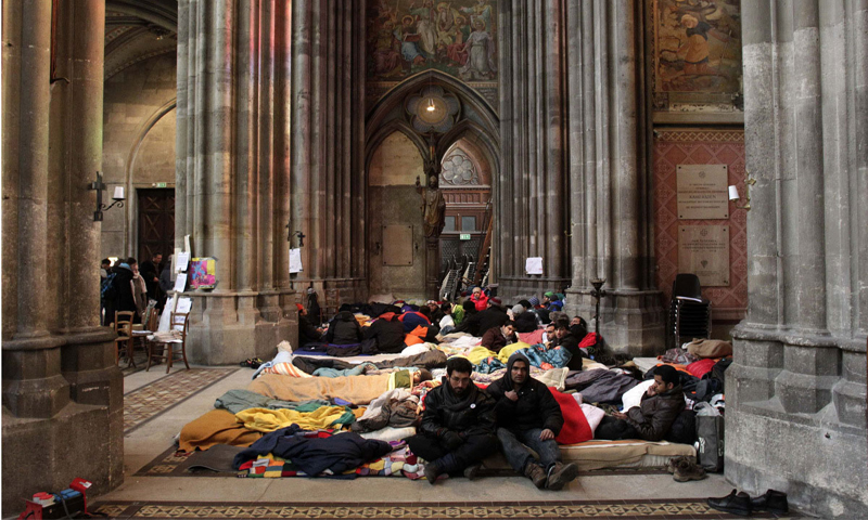 Refugees from Afghanistan and Pakistan take part in a hunger strike at a church in Vienna. 	— Reuters