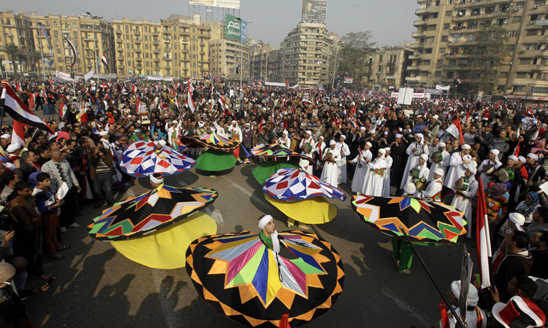 Egyptian traditional dancers perform at a pro-military rally marking the third anniversary of the 2011 uprising at Tahrir Square, in Cairo, Egypt, Saturday, Jan. 25, 2014. – AP Photo