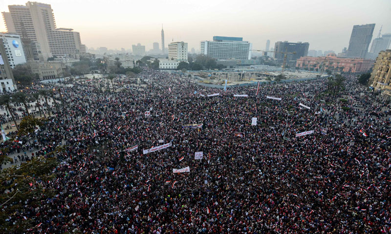 Egyptians gather in Cairo's Tahrir Square during a rally marking the anniversary of the 2011 Arab Spring uprising on January 25, 2014. – AFP