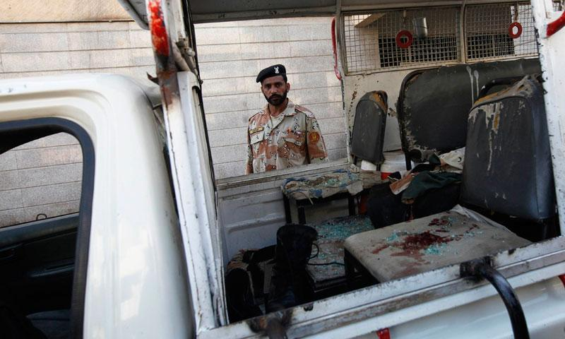 A Rangers soldier stands near a vehicle, with blood stains on a seat, after a bomb attack in Karachi January 29, 2014.—Reuters Photo