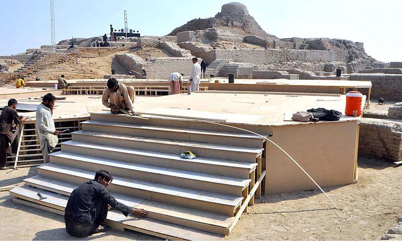 Preparations underway at Mohenjodaro for the formal launch of Sindh Festival 2014, which will be held from Feb 1 to Feb 15, to bring global recognition to the 130 heritage sites in Pakistan, especially a few of those that are in Sindh. — Photo by APP
