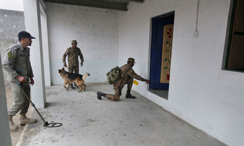 In this Wednesday, Jan. 8, 2014, photo, Pakistani soldiers search a model house during a training session at the Counter IED Explosives and Munitions School in Risalpur, Pakistan. — Photo by AP
