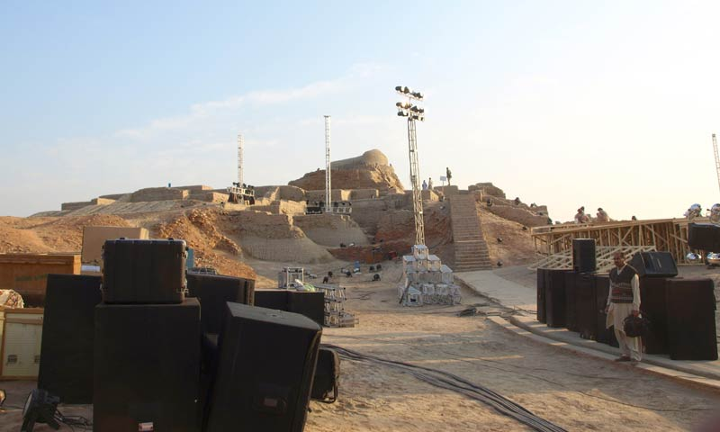Workers give final touches to the stage on January 31, 2014.—Photo by Saeed Memon