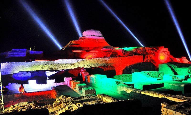 The ancient ruins of Moenjodaro illuminated  in preparation for a grand cultural festival. -APP/File Photo