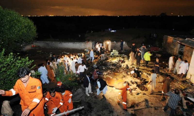 Rescue workers and local residents search the site of a plane crash in Rawalpindi on April 20, 2012. – AFP Photo/File
