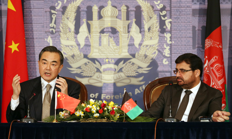 Chinese Foreign Minister Wang Yi, left, speaks during a press conference with his Afghan counterpart Zarar Ahmad Osmani at the foreign ministry in Kabul, Afghanistan, Saturday, Feb 22, 2014. – AP Photo