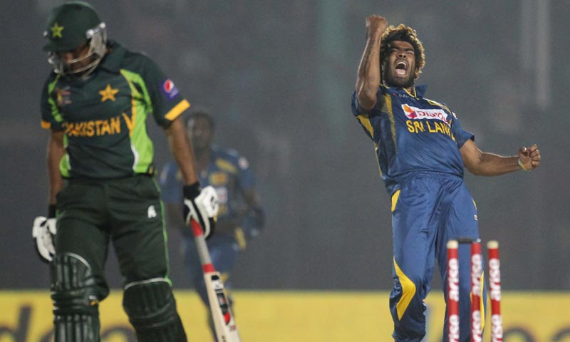 Sri Lanka's Lasith Malinga (R) celebrates the dismissal of Pakistan's Bilawal Bhatti during their one-day international (ODI) cricket match for the Asia Cup 2014 in Fatullah. -Reuters Photo