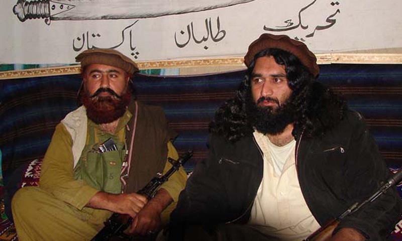 Mast Gul (left) with Mufti Hassan Swati   File