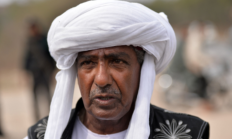 In this photograph taken on February 24, 2014 Mama (uncle) Qadeer, marches during a protest for Baloch missing people along the Grand Trunk Road in the town of Dina, some 100 kilometers south of Islamabad. — Photo by AFP