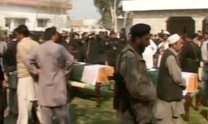 Image taken from television footage shows people gathering for the funeral of the Khasadar personnel killed in Saturday's attack on a polio vaccination team in Jamrud, Khyber agency.—Photo by Zahir Shah Sherazi