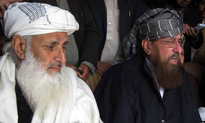TTP committee members Maulana Samiul Haq (R) and Professor Ibrahim Khan (L) hold a press conference in the northwestern town of Akora Khattak on Feb 10, 2014. — Photo by AFP