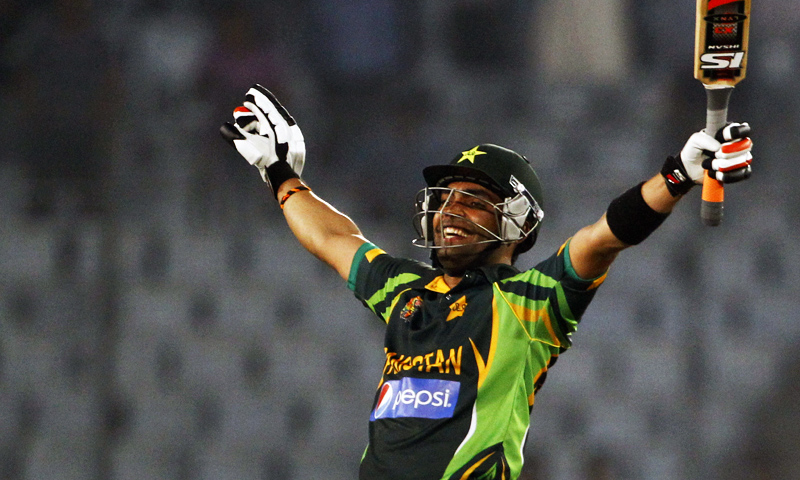 Umar Akmal celebrates after winning their match against Bangladesh in the Asia Cup one-day international cricket tournament in Dhaka, March 4, 2014. — Photo by AP