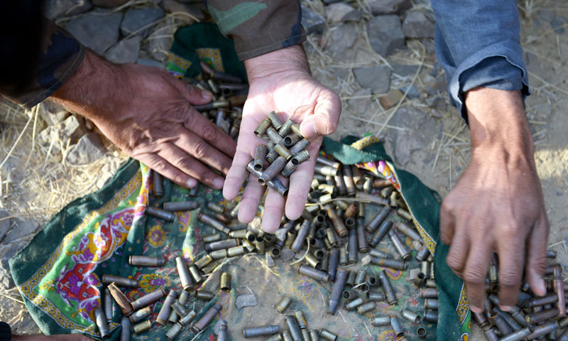 Officials unearth bullets in what they suspect was a secretarian militant camp in Tootak. — Photo by Fahim Siddiqui/White Star