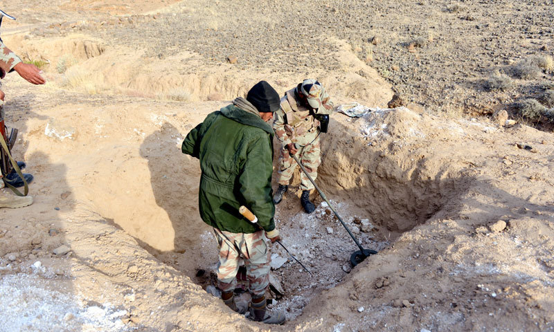 Rangers are pictured collecting evidence from the site. — Photo by Fahim Siddiqui/White Star