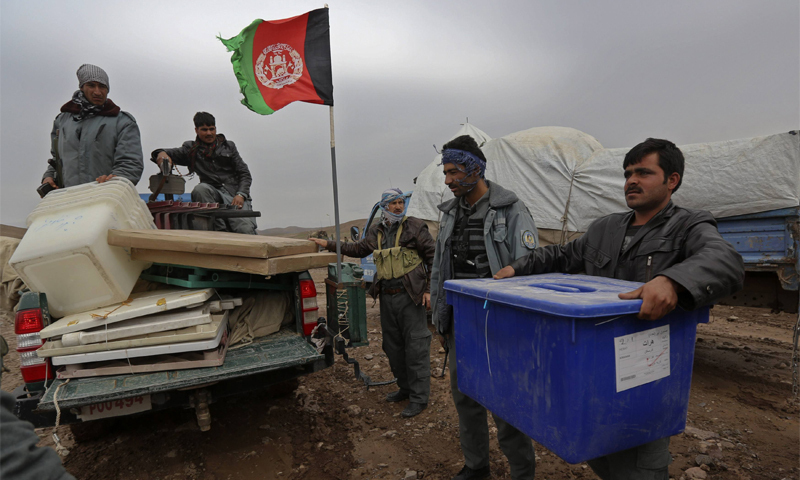Afghan election commission workers load ballot boxes on a vehicle in Ghori village of Adraskan district in Herat province on Thursday. The Afghan presidential elections will be held on Saturday.—Reuters