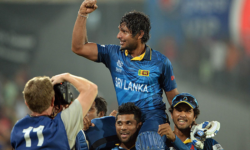 Sri Lanka batsman Kumar Sangakkara gestures towards fans after Sri Lanka won the ICC World Twenty20 cricket tournament final match against India. -AFP Photo