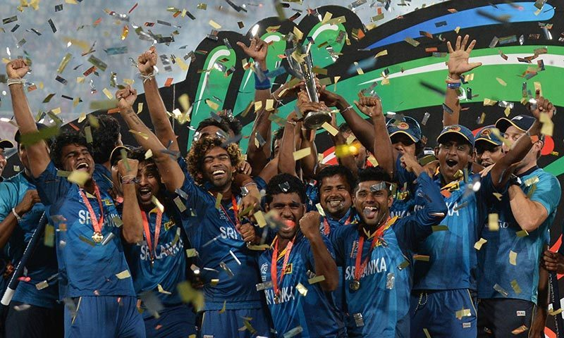 Sri Lanka cricketers celebrate with the winner's trophy after the ICC World Twenty20 cricket final match between India and Sri lanka at The Sher-e-Bangla National Cricket Stadium in Dhaka. -AFP Photo