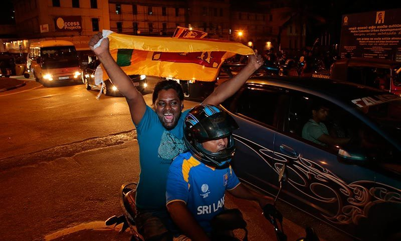 Sri Lanka cricket fans parade carrying their national flag as they celebrate in Colombo, Sri Lanka, after Sri Lanka won the ICC Twenty20 Cricket World Cup in Dhaka. -AP Photo