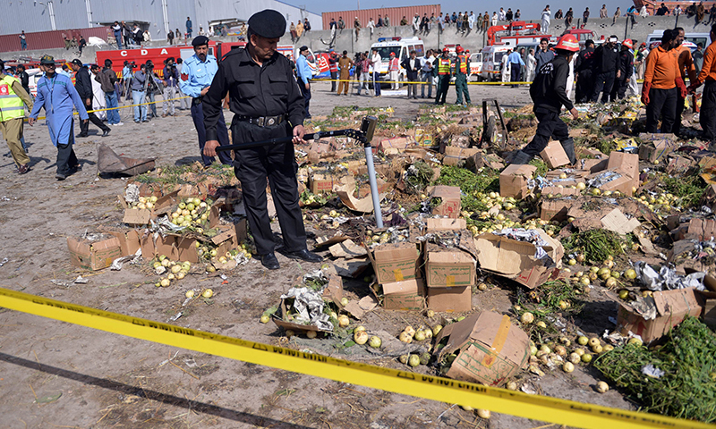 A member of the  bomb disposal suqad searches the site of the bomb explosion at a fruit and vegetable market in Islamabad on April 9, 2014.  — Photo by AFP