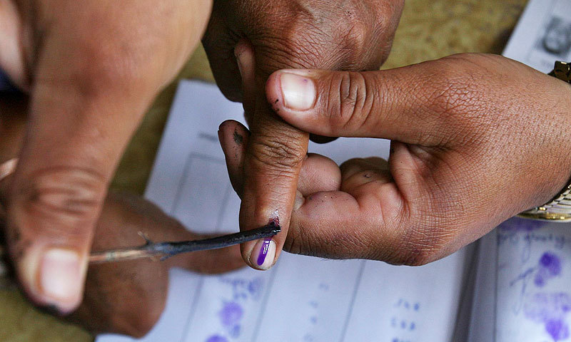 indian voter gets his finger marked with ink