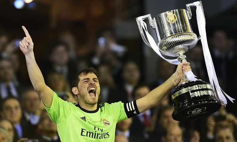 real madrid s goalkeeper iker casillas holds the trophy as he celebrates after winning the spanish copa