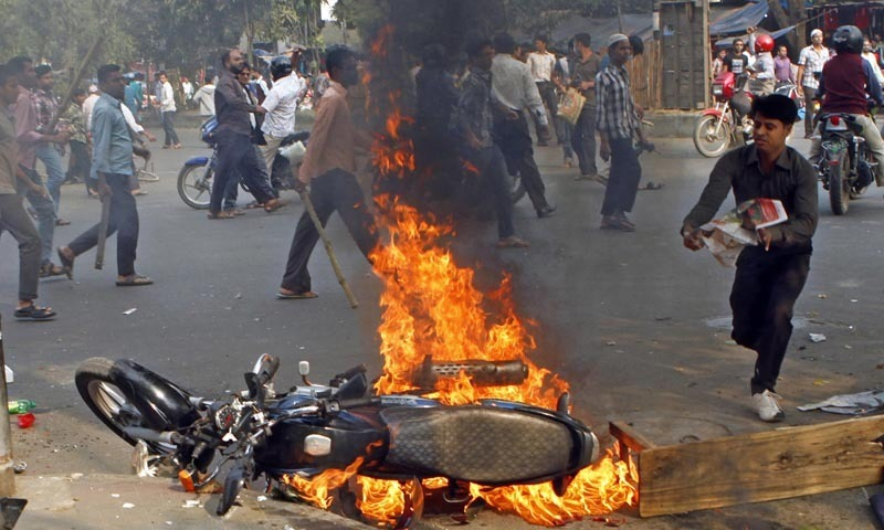 A motorbike burns as activists of Islamist party, Jamaat-e-Islami, set fire to vehicles in their protest against the execution of their party leader Abdul Quader Mollah in Dhaka. — Photo by AP/File