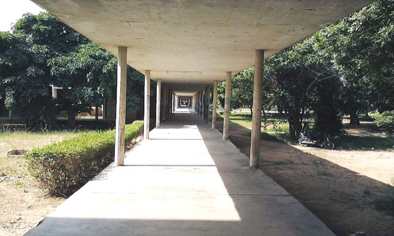 A long, shaded, open-air coridoor in KU