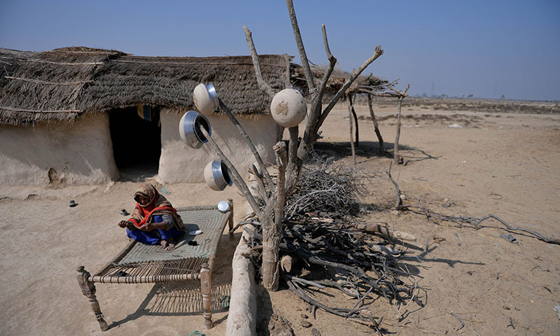 In this photograph taken on February 17, 2014 a villager sits in her home at the proposed site of the solar energy park at Badaiwani Wala village in Bahawalpur district of Punjab province. — Photo by AFP
