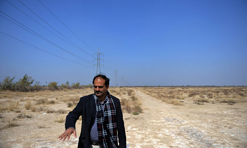 This photograph taken on February 17, 2014 shows businessman Raja Waqar of Islamabad-based Safe Solar Power visiting his land at the proposed site of the solar energy park at Badaiwani Wala village in Bahawalpur district of Punjab province.— Photo by AFP