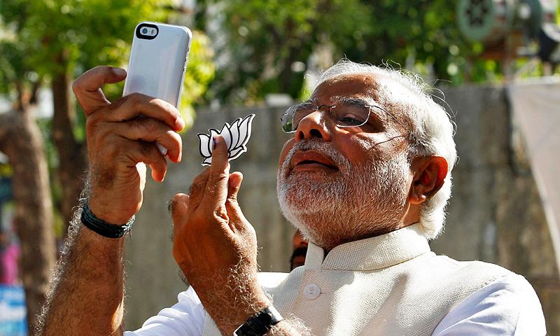 Narendra Modi takes a