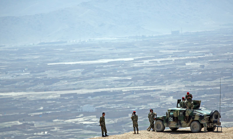 Afghan National Army (ANA) soldiers stand guard during a military exercise on the outskirts of Kabul. – AP Photo