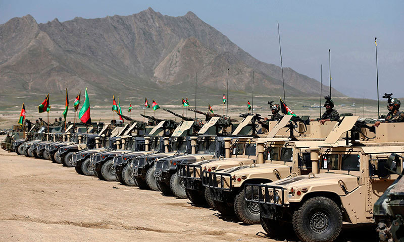 Armoured military vehicles are parked before a military exercise on the outskirts of Kabul. – Reuters Photo