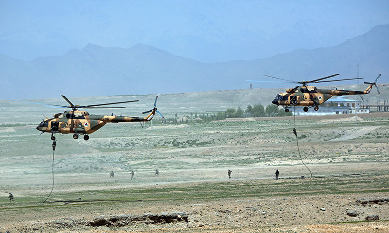 Afghan National Army (ANA) helicopters deploy soldiers during a military exercise on the outskirts of Kabul. – AP Photo