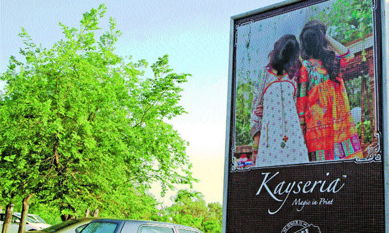 Faces of women models on advertisement billboards have been defaced. — Photo by Ishaque Chaudhry