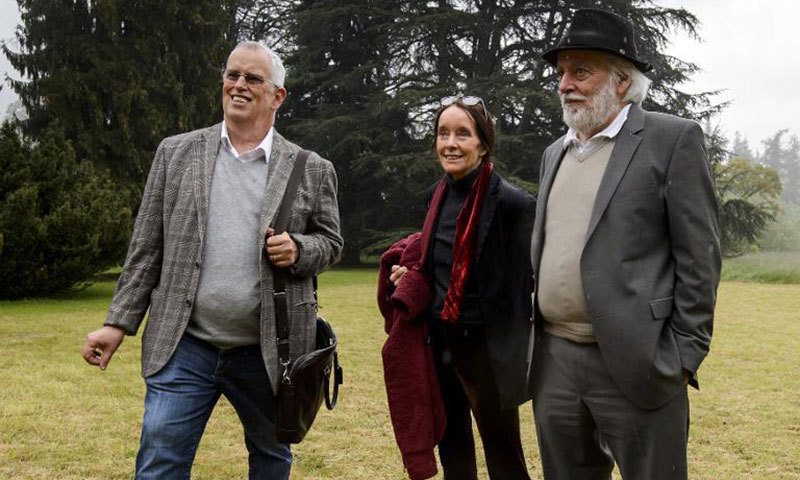 L to R: Eugene, Victoria and Michael, three of the eight children of Charlie Chaplin, pose at the Manoir de Ban during the laying of the first brick of the Chaplin Museum on May 7, 2014 in Corsier-sur-Vevey. – Photo by AFP