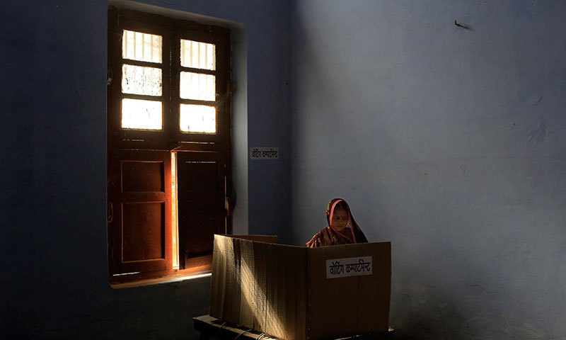 A woman casts her vote at a polling station in Varanasi, in the northern Indian state of Uttar Pradesh, Monday, May 12, 2014. Millions of Indian voters wrapped up a mammoth national election Monday. — Photo by AP