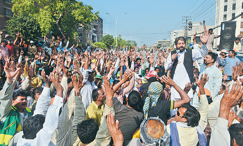 LAHORE: J. Salik leads a demonstration by Lahore Waste Management Company sweepers on Egerton Road.—White Star