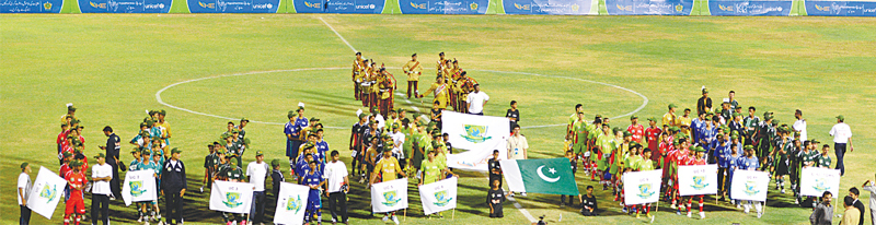Teams line up at the inauguration ceremony of the KE-Lyari U-16 League on Friday.—White Star