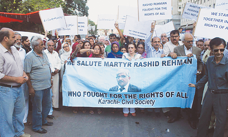 RIGHTS activists and members of civil society demonstrate at the Karachi Press Club on Sunday to condemn the killing of Rashid Rehman.—PPI