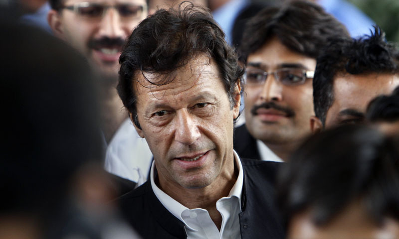 Cricketer-turned-politician and head of Pakistan Tehreek-i-Insaf Imran Khan leaves the Supreme Court after a case hearing in Islamabad, Pakistan, Wednesday, Aug 28, 2013. —AP Photo