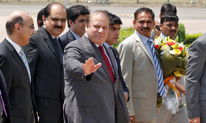 Prime Minister Nawaz Sharif waves upon his arrival at the airport in New Delhi, May 26, 2014.—Photo by Reuters