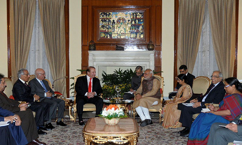 In this handout photograph released by the Press Information Bureau (PIB), Indian Prime Minister Narendra Modi (centre R) meets with his Pakistani counterpart Nawaz Sharif (centre L) at Hyderabad House in New Delhi on May 27, 2014. —AFP Photo