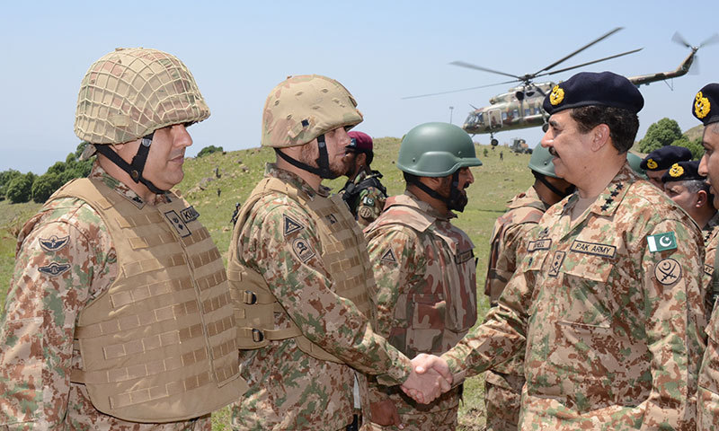 Army Chief Gen Raheel Sharif shakes hands with one the Pakistani troops deployed in Waziristan tribal region on Tuesday. – Photo provided by Mateen Haider