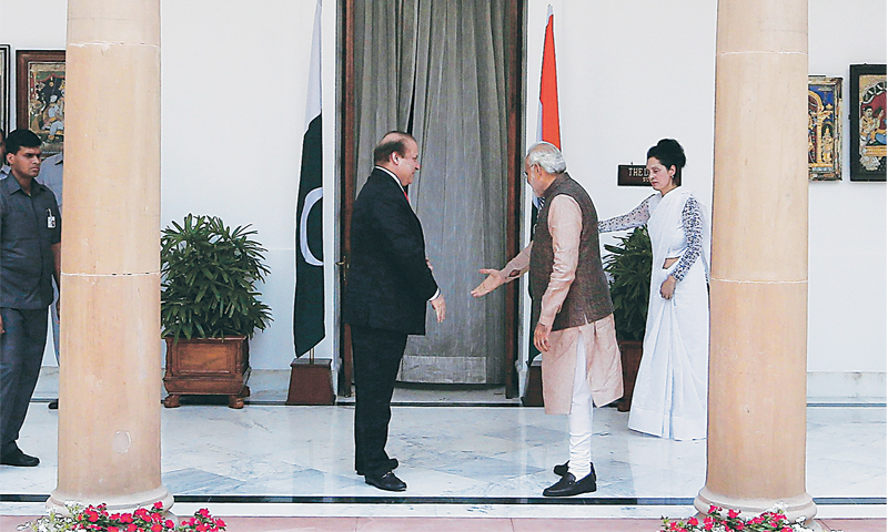 NEW DELHI: India's Prime Minister Narendra Modi pictured with his Pakistani counterpart Nawaz Sharif before their meeting here on Tuesday.—Reuters