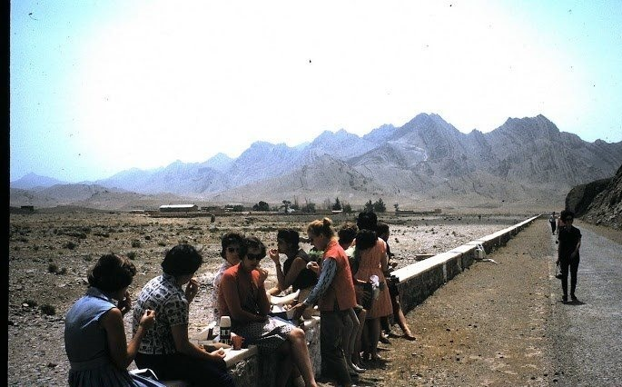 Western tourists waiting for a bus on a road leading to Quetta (1966).