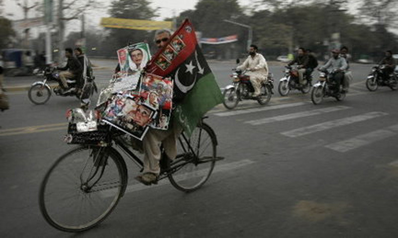 A PPP supporter campaigning for the party during the 2008 election.Opposition parties, the PPP and PML-N won the majority of the seats forcing Musharraf to resign.